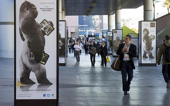 A man walks by an advertisement for Corning Gorilla Glass 3 outside the Las Vegas Convention Center.