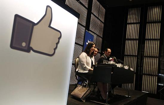 Facebook executives attend a news conference.