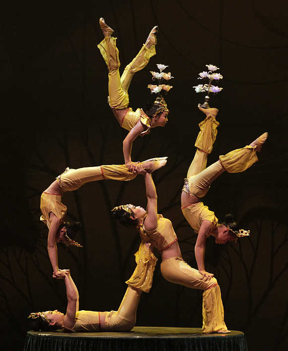 Acrobats perform during a rehearsal of China's Kunming acrobatic troupe in Bogota, Colombia.