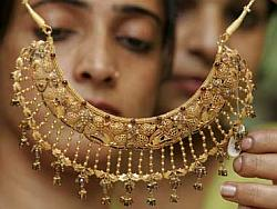 Attractive fin instruments needed to check gold demand: Rajan