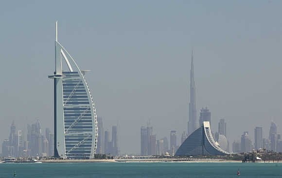 Burj Al Arab, left, a hotel, and Burj Khalifa (rear), the world's tallest tower at a height of 2,717 ft, in Dubai.