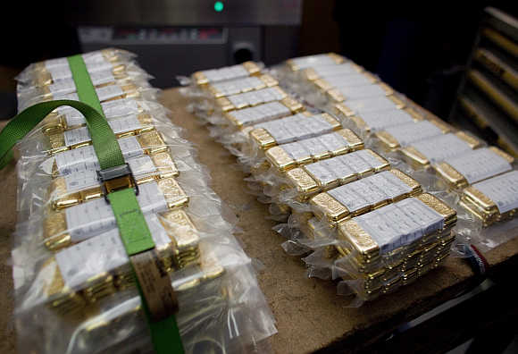 Vacuum-packed gold bars of 100 grams are placed on a table in Swiss town Mendrisio.