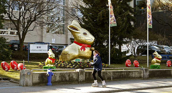 Giant gold-wrapped Easter bunnies are placed in front of the plant of Switzerland's chocolate producer Lindt & Spruengli in Kilchberg near Zurich.