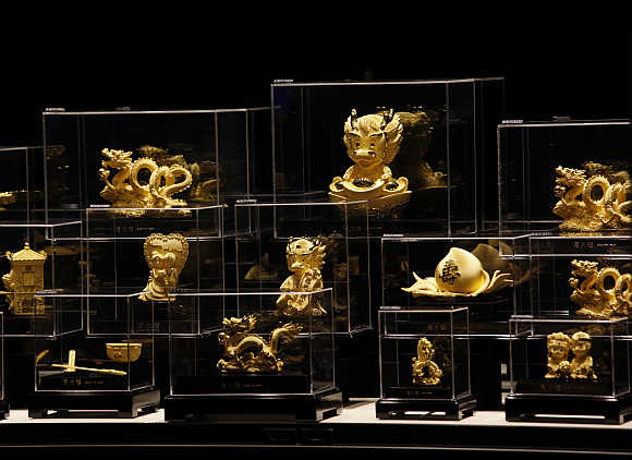 Figurines in 24K gold are displayed at a Chow Tai Fook jewellery store in Hong Kong.