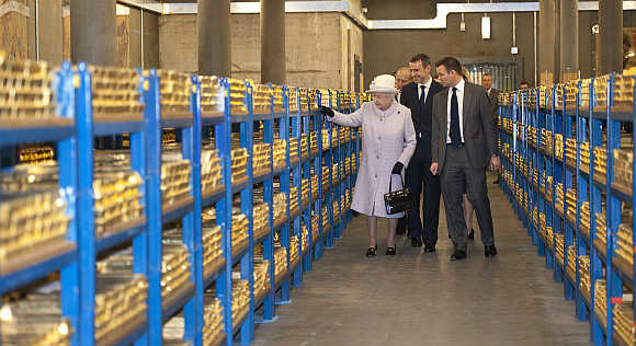 Britain's Queen Elizabeth tours a gold vault during a visit to the Bank of England in the City of London.