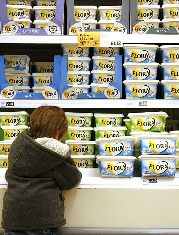 A chiller cabinet of Flora margarine, which is owned by Unilever, at a Sainsbury's supermarket in London.