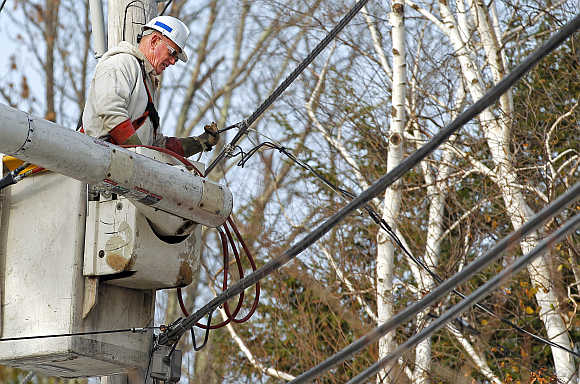 A National Grid electric worker repairs power lines in Worcester, Massachusetts.