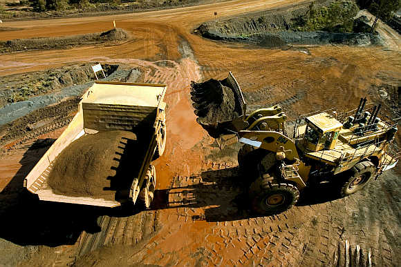 A haul truck is loaded with iron ore at a BHP Biliton mine in West Australia's Pilbara region.