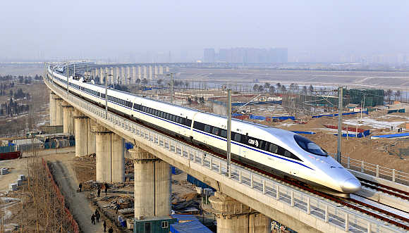 A high-speed train travelling to Guangzhou runs on Yongdinghe Bridge in Beijing.