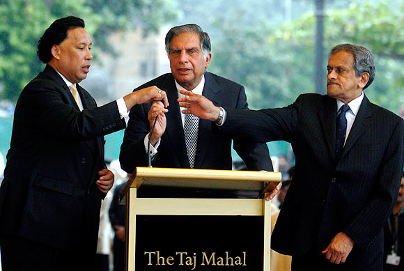 Ratan Tata with Raymond Bickson, left, managing director, Taj Hotels, and R K Krishnakumar, then vice-chairman, Indian Hotels, at the reopening of the Taj Mahal hotel in Mumbai , December 21, 2008 after the 26/11 terrorist attacks.