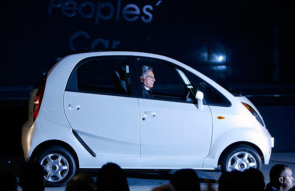 Ratan Tata with his dream project, the Nano, January 10, 2008.