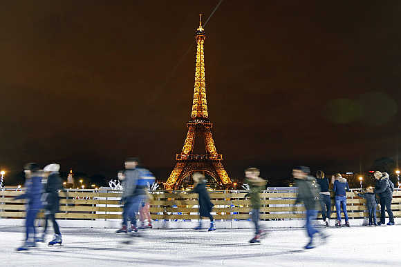 People skate on an artivicial ice rink across from the Eiffel Tower in Paris.