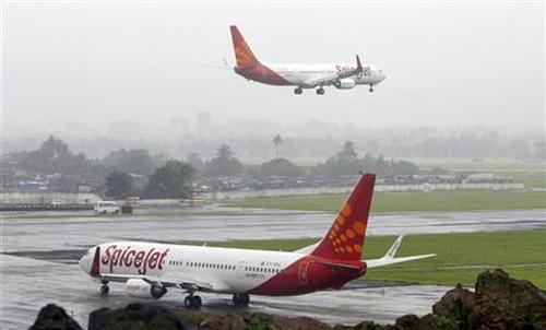 SpiceJet aircrafts prepare for landing and take-off at the airport in Mumbai.