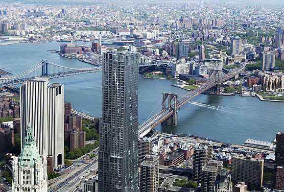 Brooklyn Bridge and Manhattan Bridge are seen from the 90th storey of One World Trade Center in New York.