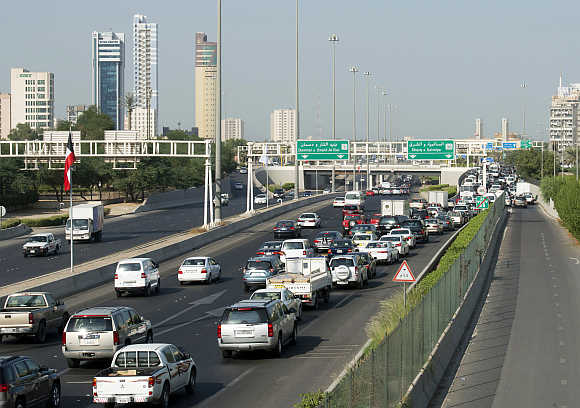 Vehicles travel on the First Ring Road in Kuwait City.