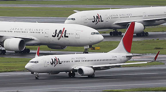 JAL aircraft are seen on the tarmac at Haneda airport in Tokyo.