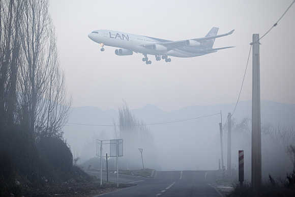 A LAN Airlines plane lands at Santiago's international airport, Chile.