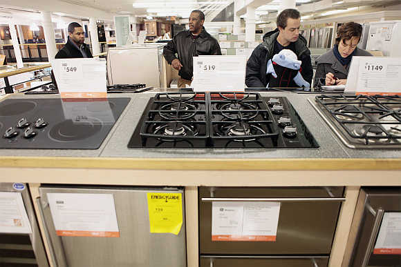 Shoppers look at durable goods appliances at a Home Depot store in New York, United States.