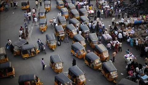 Auto rickshaws sit in a traffic jam near a market at the Charminar, Hyderabad.
