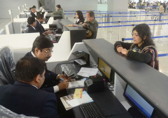 Passengers queue up for their boarding passes at the new Kolkata airport.