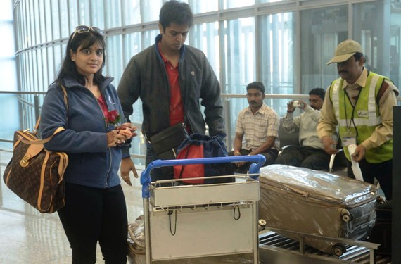 Passengers get their luggages X-rayed at the new Kolkata airport.