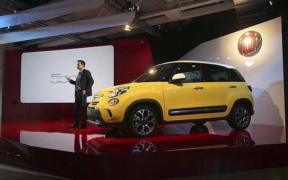 Jacob Nyborg, communication and marketing manager of Fiat Chrysler EMEA, next to the new Fiat 500L Living and Trekking model in Arcore, Italy.