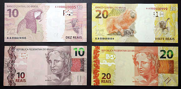 Brazilian 20 and 10 real bills are displayed at the Central Bank headquarters in Brasilia.