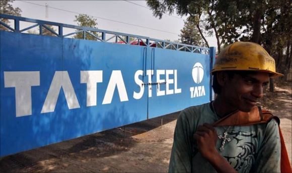 A labourer stands outside a Tata Steel stockyard in Chandigarh.