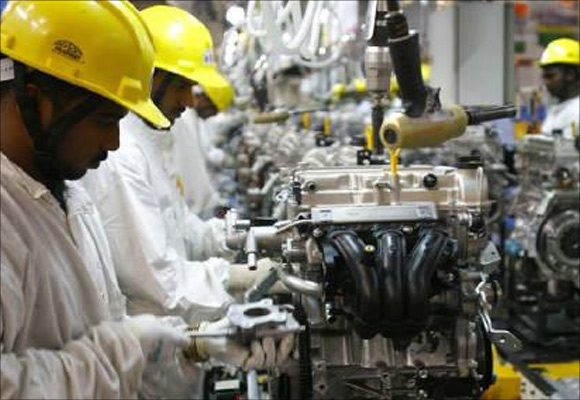 Employees work inside Maruti Suzuki's petrol engine plant on the outskirts of New Delhi.