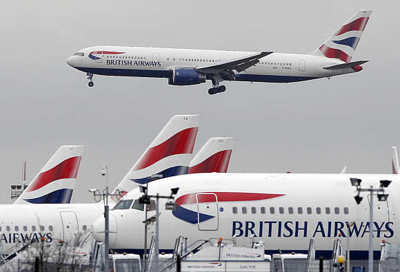 A British Airways Boeing 767 passenger plane comes into land at Heathrow Airport in London.