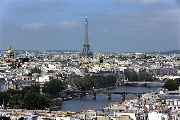A view of the Paris skyline, the Eiffel tower and the Seine River.
