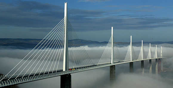 Millau Viaduct crosses the cloud-covered valley of the river Tarn in Millau, France.