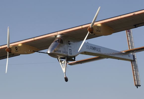 Solar Impulse's Chief Executive Officer and pilot Andre Borschberg performs a low altitude go-round procedure with the solar-powered HB-SIA prototype aircraft during a test flight at Payerne airport.