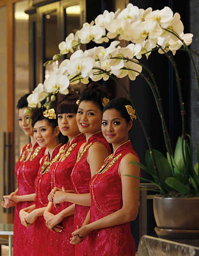 Attendants welcome guests in Macau.