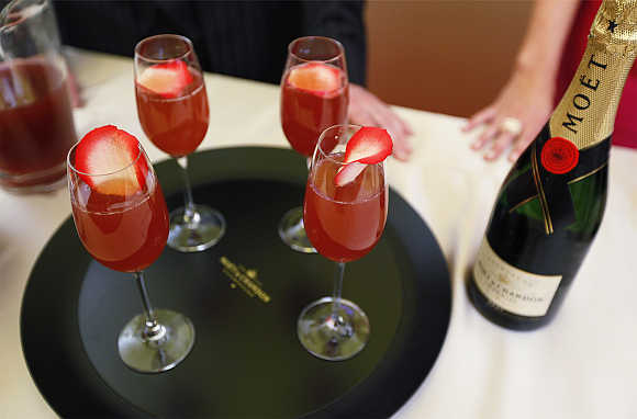 A tray of champagne cocktails rests on a table during a food and wine preview in preparation for the 84th Academy Awards in Hollywood, California.
