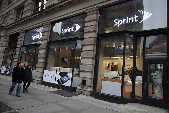 People walk past a Sprint store in New York City.