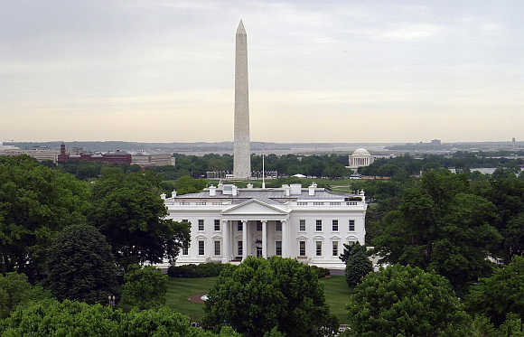White House with the Washington Monument, left, behind it and the Jefferson Memorial, right, in Washington, DC.
