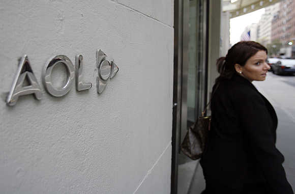A woman walks out of AOL offices in New York City.