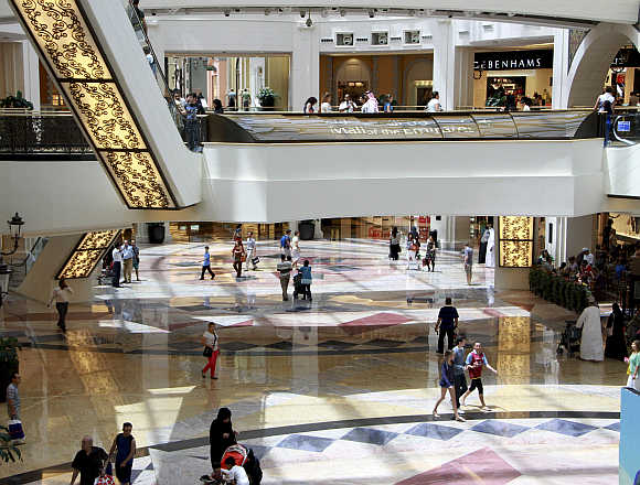 People shop at the Mall of the Emirates in Dubai, United Arab Emirates.