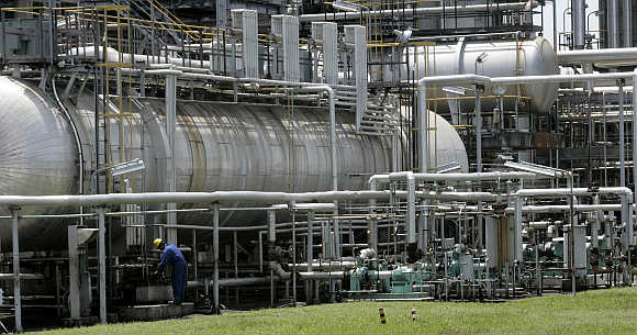 A worker checks a pipeline in the Balongan refinery belonging to Indonesia's state oil firm Pertamina in Indramayu, in West Java province. Photo is for representation purpose only.