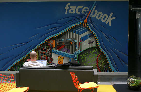 An employee works on a computer at the headquarters of Facebook in Menlo Park, California.