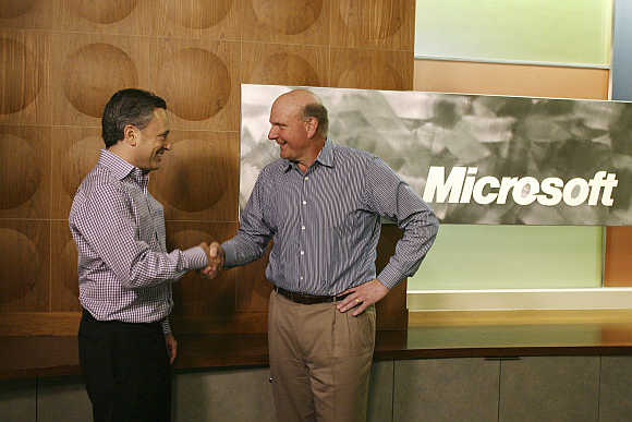 Yammer CEO David Sacks, left, and Microsoft CEO Steve Ballmer in San Francisco.