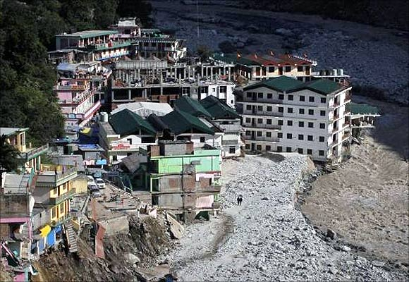 Buildings destroyed during floods are seen next to the Alaknanda river in Govindghat in the Himalayan state of Uttarakhand