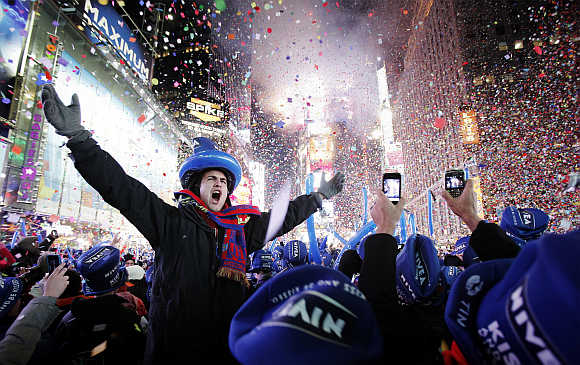 Revellers celebrate the new year in Times Square in New York City.