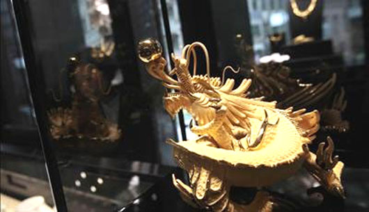 A gold statue of a dragon is displayed at a jewellery shop in Hong Kong.