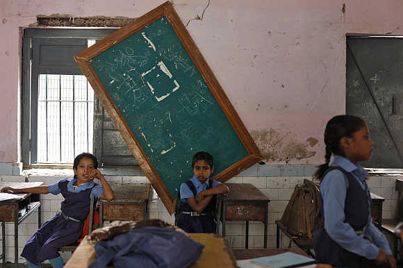 Schoolgirls inside their classroom in New Delhi.