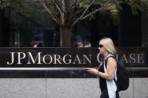 A woman walks past JPMorgan Chase & Co's international headquarters on Park Avenue in New York.