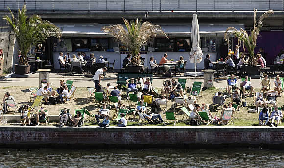People enjoy a sunny day at river Spree in Berlin's Mitte (Centre) district, Germany.