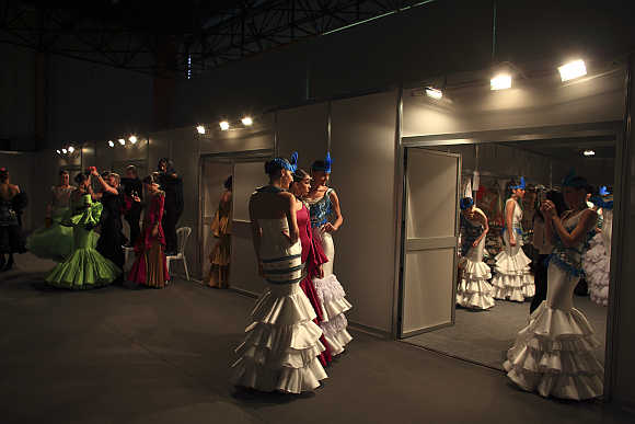 Models are seen backstage before the start of a fashion show in the Andalusian capital of Seville, Spain.
