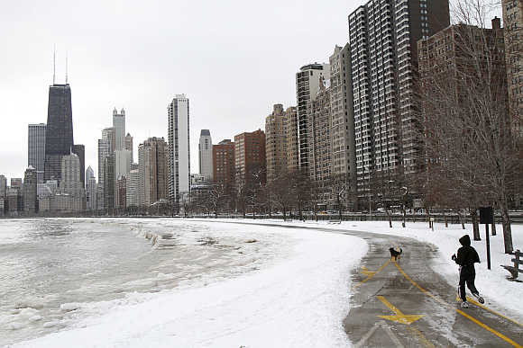 A man runs along Lake Michigan in Chicago.